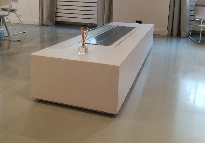Mikrocement fireplace table feature